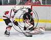 Baldwinsville Bees Shane Sweeney (44) is stopped by Mohawk Valley Raiders goalie Mike Eastman (1) in NYSPHSAA Section III Boys Ice Hockey action at the Lysander Ice Arena in Baldwinsville, New York on Tuesday, February 7, 2017. Baldwinsville won 1-0.
