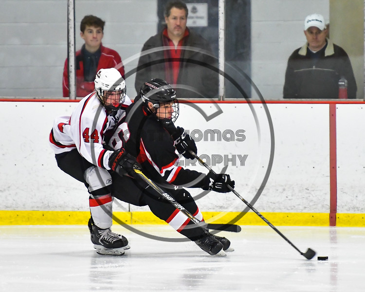 Baldwinsville Bees Shane Sweeney (44) checking Mohawk Valley Raiders Marcus Allen (16) in NYSPHSAA Section III Boys Ice Hockey action at the Lysander Ice Arena in Baldwinsville, New York on Tuesday, February 7, 2017. Baldwinsville won 1-0.
