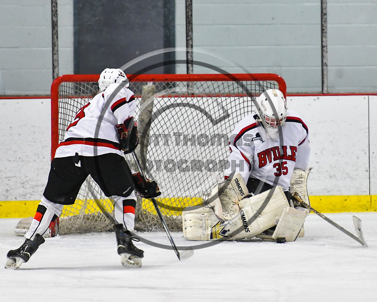 Baldwinsville Bees goalie Alex Rose (35) makes a save against the Mohawk Valley Raiders in NYSPHSAA Section III Boys Ice Hockey action at the Lysander Ice Arena in Baldwinsville, New York on Tuesday, February 7, 2017. Baldwinsville won 1-0.