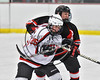 Baldwinsville Bees Jamey Natoli (25) battles for position with a Mohawk Valley Raiders player in NYSPHSAA Section III Boys Ice Hockey action at the Lysander Ice Arena in Baldwinsville, New York on Tuesday, February 7, 2017. Baldwinsville won 1-0.
