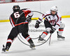 Baldwinsville Bees Connor Carhart (12) defending against Mohawk Valley Raiders Henry Froass (6) in NYSPHSAA Section III Boys Ice Hockey action at the Lysander Ice Arena in Baldwinsville, New York on Tuesday, February 7, 2017. Baldwinsville won 1-0.