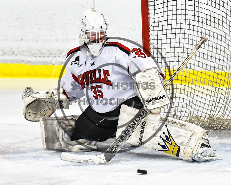Baldwinsville Bees goalie Alex Rose (35) making one of his 30 saves on his way to a shutout over the Mohawak Valley Raiders in NYSPHSAA Section III Boys Ice Hockey action at the Lysander Ice Arena in Baldwinsville, New York on Tuesday, February 7, 2017. Baldwinsville won 1-0.