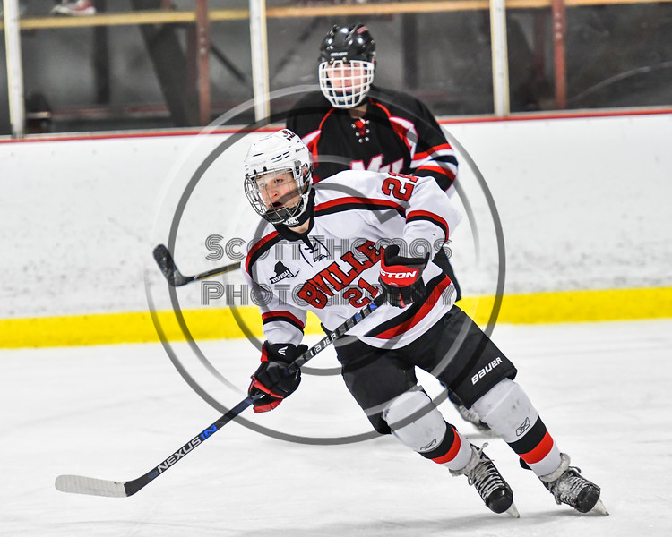 Baldwinsville Bees Cameron Sweeney (21) on the ice against the Mohawk Valley Raiders in NYSPHSAA Section III Boys Ice Hockey action at the Lysander Ice Arena in Baldwinsville, New York on Tuesday, February 7, 2017. Baldwinsville won 1-0.