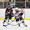 Baldwinsville Bees Shane Sweeney (44) with the puck against the Mohawk Valley Raiders in NYSPHSAA Section III Boys Ice Hockey action at the Lysander Ice Arena in Baldwinsville, New York on Tuesday, February 7, 2017. Baldwinsville won 1-0.