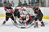 Baldwinsville Bees Cameron Sweeney (21) crashes the Mohawak Valley Raiders but is stopped by goalie Michael Eastman (1) in NYSPHSAA Section III Boys Ice Hockey action at the Lysander Ice Arena in Baldwinsville, New York on Tuesday, February 7, 2017. Baldwinsville won 1-0.
