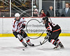 Baldwinsville Bees Zach Perez (26) stickhandling around a Mohawk Valley Raiders defender in NYSPHSAA Section III Boys Ice Hockey action at the Lysander Ice Arena in Baldwinsville, New York on Tuesday, February 7, 2017. Baldwinsville won 1-0.