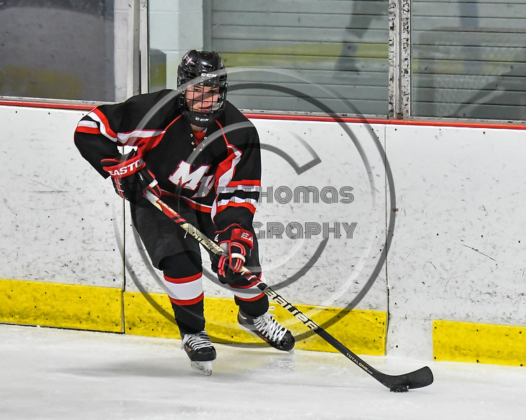 Mohawk Valley Raiders player with the puck against the Baldwinsville Bees in NYSPHSAA Section III Boys Ice Hockey action at the Lysander Ice Arena in Baldwinsville, New York on Tuesday, February 7, 2017. Baldwinsville won 1-0.