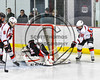 Baldwinsville Bees Anthony Pompo (55) has his wrap around attempt stopped by Mohawk Valley Raiders goalie Mike Eastman (1) in NYSPHSAA Section III Boys Ice Hockey action at the Lysander Ice Arena in Baldwinsville, New York on Tuesday, February 7, 2017. Baldwinsville won 1-0.