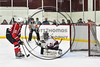Baldwinsville Bees Chris Speelman (23) scores a goal against Syracuse Cougars goalie Jake Polacek  (29) on a penalty shot in a Section III, Division I Playoff game at the Meachem Ice Rink in Syracuse, New York on Wednesday, February 22, 2017. Syracuse won 3-2 in overtime.