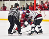 Baldwinsville Bees and Syracuse Cougars face-off to start the overtime period in a Section III, Division I Playoff game at the Meachem Ice Rink in Syracuse, New York on Wednesday, February 22, 2017. Syracuse won 3-2 in overtime.