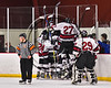 Syracuse Cougars celebrate Andrew Hodgens'  (19) overtime goal to beat the Baldwinsville Bees in a Section III, Division I Playoff game at the Meachem Ice Rink in Syracuse, New York on Wednesday, February 22, 2017. Syracuse won 3-2 in overtime.