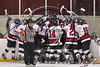 Syracuse Cougars celebrate their overtime win over the Baldwinsville Bees in a Section III, Division I Playoff game at the Meachem Ice Rink in Syracuse, New York on Wednesday, February 22, 2017. Syracuse won 3-2 in overtime.