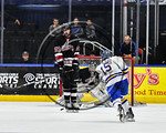 West Genesee Wildcats Daniel Colabufo (15) fires the puck at Syracuse Cougars goalie Jake Polacek (29) in the Section III, Division I Boys Ice Hockey Championship game at the War Memorial Ar ...