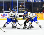 West Genesee Wildcats and Syracuse Cougars battle for the loose puck after the face-off to start overtime in the Section III, Division I Boys Ice Hockey Championship game at the War Memorial ...