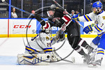 West Genesee Wildcats goalie Sammy Colabufo (29) makes save as Syracuse Cougars Ryan Eccles (23) crashes the net in the Section III, Division I Boys Ice Hockey Championship game at the War M ...