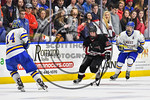 Syracuse Cougars Matt Frye (21) with the puck against the West Genesee Wildcats in the Section III, Division I Boys Ice Hockey Championship game at the War Memorial Arena in Syracuse, New Yo ...