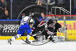 Syracuse Cougars goalie Jake Polacek (29) makes a save against West Genesee Wildcats Daniel Colabufo (15) in the Section III, Division I Boys Ice Hockey Championship game at the War Memorial ...