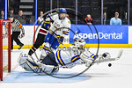 West Genesee Wildcats goalie Sammy Colabufo (29) dives on a rebound agianst the Syracuse Cougars in the Section III, Division I Boys Ice Hockey Championship game at the War Memorial Arena in ...