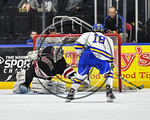 West Genesee Wildcats Patrick McDonald (18) looking for a rebound off a save by Syracuse Cougars goalie Jake Polacek (29) in the Section III, Division I Boys Ice Hockey Championship game at  ...