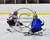 Baldwinsville Bees Parker Schroeder (8) looses the race to a loose puck with Watertown IHC Cavaliers goalie Stefon Lucidi (31) in NYSPHSAA Section III Boys Ice hockey action at the Lysander Ice Arena in Baldwinsville, New York on Tuesday, November 28, 2017. Baldwinsville won 7-1.