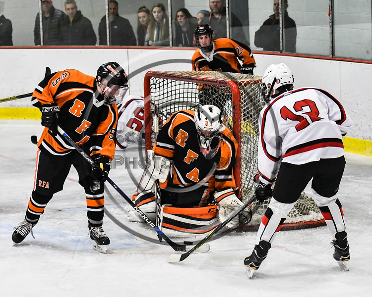 Baldwinsville Bees Alexander Pompo (12) has his shot blocked by Rome Free Academy Black Knights goalie Ethan Siderine (31) in NYSPHSAA Section III Boys Ice hockey action at the Lysander Ice Arena in Baldwinsville, New York on Tuesday, December 5, 2017. Baldwinsville won 5-0.