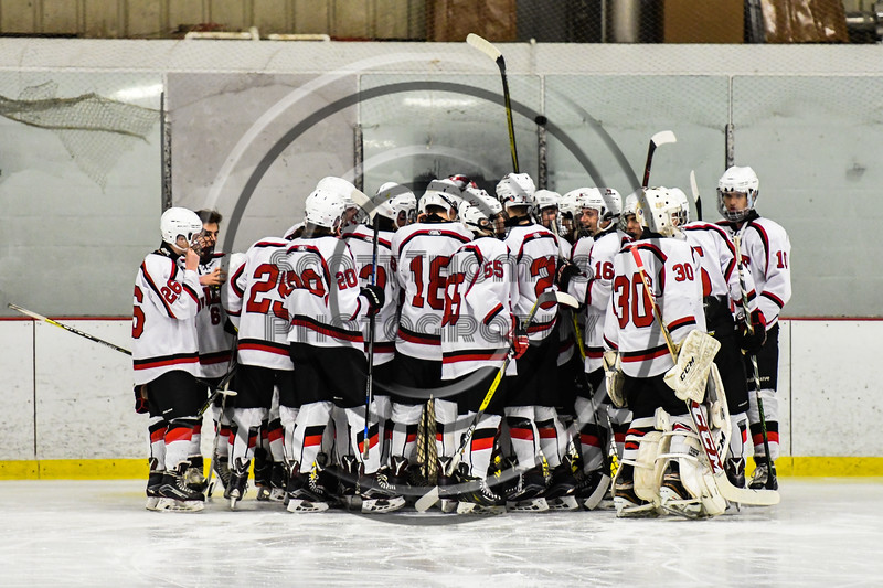 Baldwinsville Bees huddle up before playing the Rome Free Academy Black Knights in a NYSPHSAA Section III Boys Ice hockey game at the Lysander Ice Arena in Baldwinsville, New York on Tuesday, December 5, 2017.