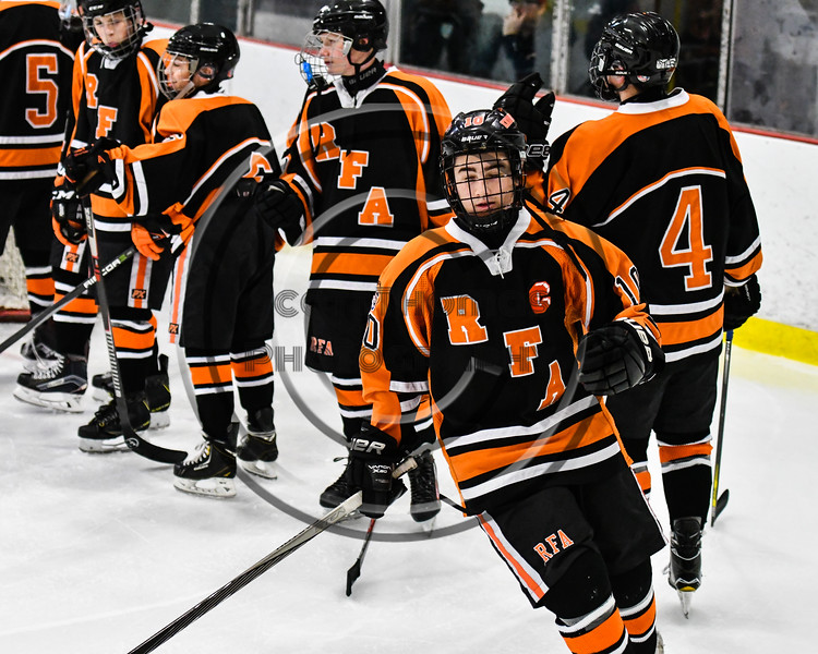 Rome Free Academy Black Knights Captain Michael Haag (10) being introduced before playing the Baldwinsville Bees a NYSPHSAA Section III Boys Ice hockey game at the Lysander Ice Arena in Baldwinsville, New York on Tuesday, December 5, 2017.
