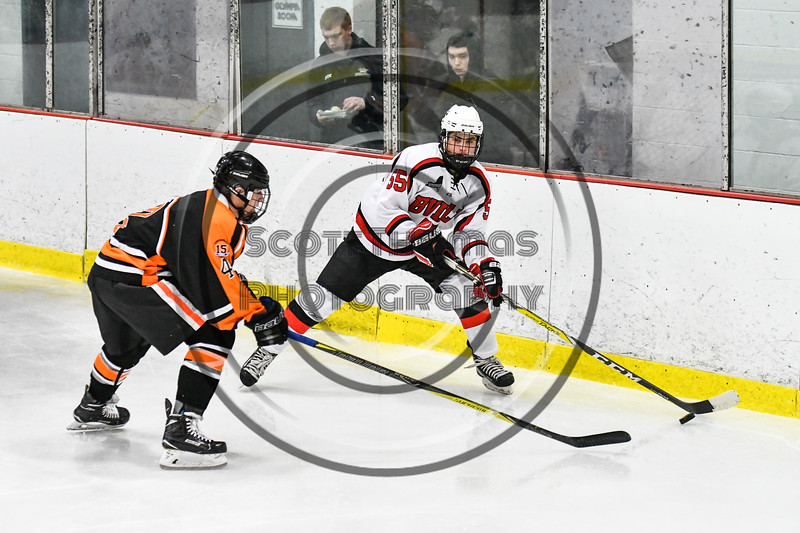 Baldwinsville Bees Anthony Pompo (55) looking to make a play against a Rome Free Academy Black Knights defender in NYSPHSAA Section III Boys Ice hockey action at the Lysander Ice Arena in Baldwinsville, New York on Tuesday, December 5, 2017. Baldwinsville won 5-0.