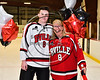 Baldwinsville Bees Parker Schroeder (8) honors Mrs. Barry on Teacher Appreciation Night at the Lysander Ice Arena in Baldwinsville, New York on Tuesday, January 9, 2018.