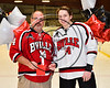Baldwinsville Bees Nick Glamos (14) honors James Cuyler on Teacher Appreciation Night at the Lysander Ice Arena in Baldwinsville, New York on Tuesday, January 9, 2018.