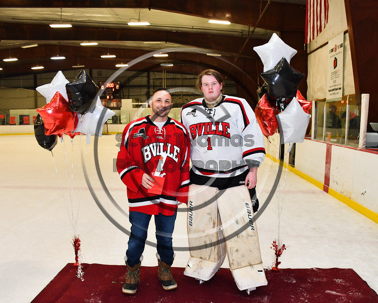 Baldwinsville Bees goalie Josh Smith (1) honors Mr. D'Agostino on Teacher Appreciation Night at the Lysander Ice Arena in Baldwinsville, New York on Tuesday, January 9, 2018.