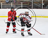 Baldwinsville Bees Brad O'Neill (39) looking for the puck against Fulton Red Raiders Joseph Calvagno (5) in NYSPHSAA Section III Boys Ice hockey action at the Lysander Ice Arena in Baldwinsville, New York on Tuesday, January 9, 2018. Baldwinsville won 9-1.