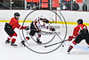 Baldwinsville Bees Nick Glamos (14) gets a shot off between two Fulton Red Raiders defenders in NYSPHSAA Section III Boys Ice hockey action at the Lysander Ice Arena in Baldwinsville, New York on Tuesday, January 9, 2018. Baldwinsville won 9-1.