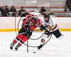 Baldwinsville Bees Brett Sabourin (10) skating with the puck while being defended by RFA Black Knights Kyle Lubey (3) in Section III Boys Ice Hockey action at the John F. Kennedy Arena in Rome, New York on Tuesday, January 23, 2018. Baldwinsville won 4-2.