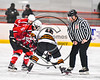 Baldwinsville Bees and RFA Black Knights face-off to start a Section III Boys Ice Hockey game at the John F. Kennedy Arena in Rome, New York on Tuesday, January 23, 2018. Baldwinsville won 4-2.