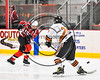 Baldwinsville Bees Ben Dwyer (17) fires the puck past RFA Black Knights Tommy Yoxall (26) in Section III Boys Ice Hockey action at the John F. Kennedy Arena in Rome, New York on Tuesday, January 23, 2018. Baldwinsville won 4-2.