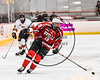 Baldwinsville Bees Alex Schmidt (19) with the puck against the RFA Black Knights in Section III Boys Ice Hockey action at the John F. Kennedy Arena in Rome, New York on Tuesday, January 23, 2018. Baldwinsville won 4-2.