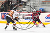 Baldwinsville Bees Tanner McCaffrey (2) with the puck against RFA Black Knights Tommy Yoxall (26) in Section III Boys Ice Hockey action at the John F. Kennedy Arena in Rome, New York on Tuesday, January 23, 2018. Baldwinsville won 4-2.
