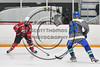 Baldwinsville Bees Mark Monaco (22) with the puck against Cicero-North Syracuse Northstars Jacob DenBleyker (20) in Section III Boys Ice Hockey action at the Cicero Twin Rinks in Cicero, New York on Tuesday, January 30, 2018. Baldwinsville won 1-0.
