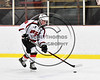 Baldwinsville Bees Parker Schroeder (8) with the puck against the Ithaca Little Red in NYSPHSAA Section III Boys Ice hockey action at the Lysander Ice Arena in Baldwinsville, New York on Friday, February 9, 2018. Ithaca won 1-0.