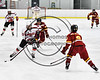 Baldwinsville Bees Cameron Sweeney (21) with the puck against Ithaca Little Red defenders in NYSPHSAA Section III Boys Ice hockey action at the Lysander Ice Arena in Baldwinsville, New York on Friday, February 9, 2018. Ithaca won 1-0.