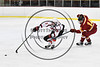 Baldwinsville Bees Isaiah Pompo (5) avoids a check from Ithaca Little Red Brian Conuel (14) in NYSPHSAA Section III Boys Ice hockey action at the Lysander Ice Arena in Baldwinsville, New York on Friday, February 9, 2018. Ithaca won 1-0.