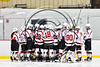Baldwinsville Bees huddle up before playing the Ithaca Little Red in a NYSPHSAA Section III Boys Ice hockey game at the Lysander Ice Arena in Baldwinsville, New York on Friday, February 9, 2018.
