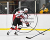 Baldwinsville Bees Alex Schmidt (19) skating with the puck against the Ithaca Little Red in NYSPHSAA Section III Boys Ice hockey action at the Lysander Ice Arena in Baldwinsville, New York on Friday, February 9, 2018. Ithaca won 1-0.