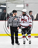 Baldwinsville Bees Isaiah Pompo (5) talks with a referee before playing the Mohawk Valley Raiders in a NYSPHSAA Section III Boys Ice hockey playoff game at the Lysander Ice Arena in Baldwinsville, New York on Friday, February 16, 2018.