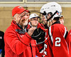 Baldwinsville Bees Head Coach Mark Lloyd greets Tanner McCaffrey (2) after McCaffrey scored the winning shootout goal against the West Genesee Wildcats in NYSPHSAA Section III Boys Ice hockey playoff action at Shove Park in Camillus, New York on Wednesday, February 21, 2018. Baldwinsville won 2-1 in a Shootout.