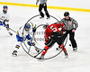 Baldwinsville Bees Isaiah Pompo (5) faces off against West Genesee Wildcats Billy Fisher (8) to start a NYSPHSAA Section III Boys Ice hockey playoff game at Shove Park in Camillus, New York on Wednesday, February 21, 2018. Baldwinsville won 2-1 in a Shootout.