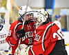 Baldwinsville Bees Alex Schmidt (19) congratulates Bees goalie Jeremy Rappard (30) after the shootout win over the West Genesee Wildcats in NYSPHSAA Section III Boys Ice hockey playoff action at Shove Park in Camillus, New York on Wednesday, February 21, 2018. Baldwinsville won 2-1 in a Shootout.