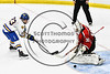 Baldwinsville Bees goalie Jeremy Rappard (30) makes a save against West Genesee Wildcats Daniel Holzhauer (23) in NYSPHSAA Section III Boys Ice hockey playoff shootout action at Shove Park in Camillus, New York on Wednesday, February 21, 2018. Baldwinsville won 2-1 in a Shootout.