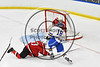 West Genesee Wildcats Patrick McDonald (18) shot is stopped by Baldwinsville Bees goalie Jeremy Rappard (30) in NYSPHSAA Section III Boys Ice hockey playoff action at Shove Park in Camillus, New York on Wednesday, February 21, 2018. Baldwinsville won 2-1 in a Shootout.